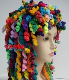 Rag Doll Bonnet by Iryna on Etsy ... although this looks really complicated it's not --- would be cute as the wig for a Merida (from Brave) wig!