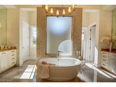 28901 Somers Dr, Naples, FL 34119 | Large luxurious master bathroom with soaking tub and walk through shower.  Golf estate in Quail West.  Naples, Florida - Melinda Gunther