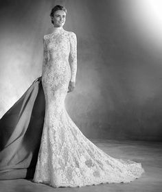 Atelier Pronovias full lace, high necked, long sleeved fishtail wedding dress, available at Miss Bush, Surrey.