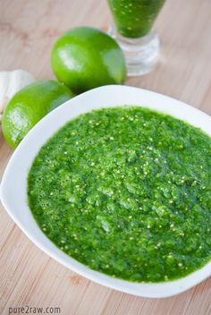 Spinach Salsa Verde - Ingredients    - 2 tomatillos  - 2 small onions  - 4 garlic cloves  - 1 bunch cilantro  - 1 lime  - dash sea salt  - added in about a half pound of spinach  - used 2 semi-hot peppers    place all ingredients into a blender and blend till combined. we actually did ours in stages and added the spinach and cilantro last.