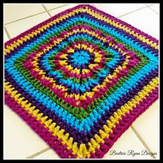 Rainbow_burst_square...Reversible granny..front is a burst and back is a flower motif!... Free pattern!!
