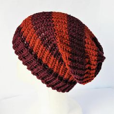 Check out this item in my Etsy shop https://www.etsy.com/uk/listing/532952817/purple-and-orange-hat-striped-slouchy