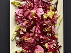 Beet and Apple Salad Recipe  (Rita's modifications: * 3 small beets to 2 apples * shred carrot in same manner as beets * no sugar, but add a couple Tbsp balsamic vinegar * upped the walnuts to taste * no endive at the store)