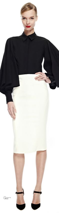 Dramatic sleeves no longer requires shoulder cushions or ruching, but billow with width in a shape resembling bishop sleeves.  Zac Posen, FW 2014