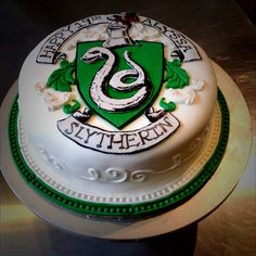 Slytherin house birthday cake. #bakeshopoakland #birthdaycake #harrypotter http://www.bakeshopoakland.com/