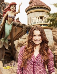 In this handout photo provided by Disney Parks, actress JoAnna Garcia, who portrays Ariel on the ABC series 'Once Upon A Time,' poses in front of the 'Under the Sea - Journey of The Little Mermaid' attraction at the Magic Kingdom theme park at Walt Disney World Resort November 15, 2013 in Lake Buena Vista, Florida.
