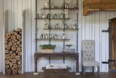 Love the open shelves with the silver or mercury containers and the nifty wood pile stock of  Rachel Halvorson designs