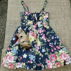 """Abercrombie Dress Worn once, no signs or wear. Cutest dress ever, very flirty and feminine. The color looks faded but that is the way it suppose to look. Elastic back, adjustable spaghetti straps, and ruffles in the linen of the skirt makes it puffy, and pockets!! Juniors size Medium, it could work for a Size 2 or Size XS on misses. Length 26"""" not including shoulder straps, bust 15"""", waist 13"""", fabric 100% cotton ***OFFERS WELCOME *** Abercrombie & Fitch Dresses"""