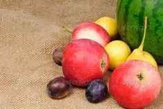 Fresh fruit on on the burlap background ...  agriculture, apple, background, bagging, bright, brown, burlap, cloth, colorful, delicious, dessert, diet, dieting, eat, food, fresh, freshness, fruit, green, healthy, hessian, juicy, nature, organic, pears, plant, plums, red, ripe, sack, sweet, vegetarian, vivid, watermelon