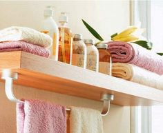 Cool and Simple Bathroom Storage Ideas for Small Spaces --- I like the idea of a towel rod under a floating shelf