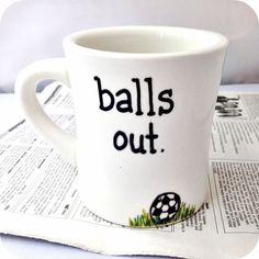 Hand painted mug with balls out and a soccer ball motif.  Are you ready for some football? Or soccer, if thats your preferred term? Bring it! The countries. The spectacle. The sport. The penalty shootouts. Yes! Ole, ole, ole, oleeee! Stop playing with your balls... get them out! On the pitch...  -- Mug is microwave and dishwasher safe. Ink is heat-set but please do not use abrasives on the painted surface. Mug is approximately 3.75 tall and holds about 8 oz, but weighs over a pound (which is…