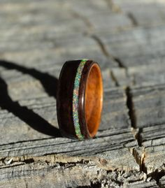 bentwood ring | wood ring | wood band | wood wedding band | ebony ring | ebony opal ring ********************** This bentwood ring is made of Ebony with a Rosewood liner and offset opal inlay. The ebony wood is very deep black and is nicely contrasted with the rosewood liner. The opal inlay is Wood Inlay Rings, Wood Rings, Opal Jewelry, Sea Glass Jewelry, Cute Jewelry, Women Jewelry, How To Make Rings, Titanium Rings, Jewerly