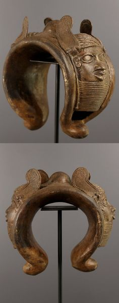 Nigeria | Royal Benin bracelet; decorated with the head of the Oba on both sides | Bronze; 3kgs weight | 2nd half of the 20th century  || Reserved