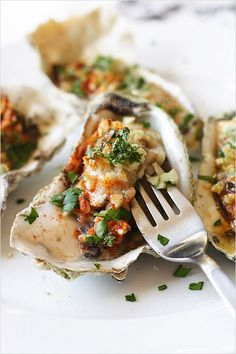 Baked Oysters recipe - this recipe calls for finely chopped garlic, parsley leaves, salt, paprika, and butter (use a healthier alternative) oysters #seafood #dinner