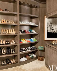 DeGeneres and De Rossi's shoe shelves are filled with their respective sneakers and stilettos | archdigest.com
