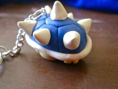 This keychain is inspired by the Super Mario games. It measures an inch and a half tall and 2 inches long, and is made of polymer clay. It can also be made into a necklace. Also, I can add wings to it, like some Spiny shells have.   When ordering please let me know your preferences about the ab...