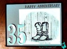 """Made this card for my hubby celebrating our 35th Wedding Anniversary. My hubby ALWAYS wears boots. Cowboy boots, motorcycle boots, flight boots, you name it he's probably wore them. With this card I used Basic Black cardstock for the base. Basic Gray and Whisper White cardstock. Soft Sky and Basic Black ink. I used the """"Country Livin"""" stamp set for the boots, """"Number of Years"""" for the years (of course) and the """"Hardwood"""" background stamp."""