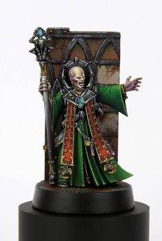Image result for Genestealer Magus with a plinth and a miniature map in front of him