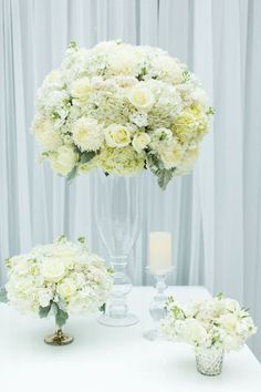Luxurious all white wedding centerpiece; Click to see more amazing wedding ideas; via Charmed Events Group; photo: Meg Perotti