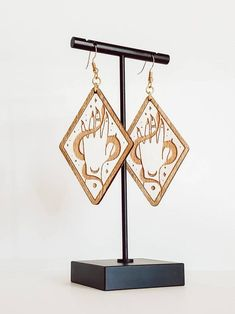 Bring your Magick with you wherever you go in these mystical hand earrings. Features an adorned hand and snake with gold gilding. Photos can't capture their beautiful shine! I know you're going to look amazing in them. Wood Earrings, Dangle Earrings, Witch Fashion, Goth Aesthetic, Gold Gilding, Pastel Goth, Occult, Magick, Tarot