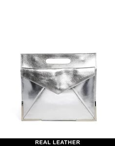 Image from http://cdn1.picvpicimg.com/pics/5239776/silver-asos-asos-leather-organiser-clutch-bag-with-metal-corners-screen.jpg.