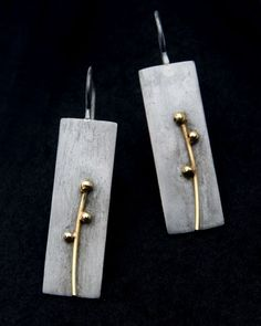 """Contemporary Jewelry Design by Andrea Williams: Kebyar Spring Drops: The Kebyar Spring Drop Earrings are hand fabricated from patinated reclaimed Sterling silver & 18k gold. These earrings are part of a series reflecting the seasons. Kebyar is a Balinese word meaning """"the process of flowering""""."""