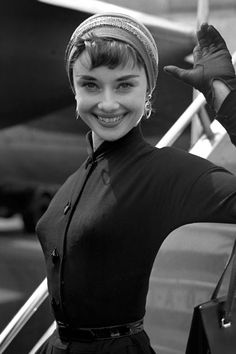 1953 - Hepburn covered up with a headscarf as she arrived in London after a flight from New York