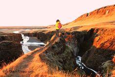 Hiker in Fjadrargljufur canyon Iceland