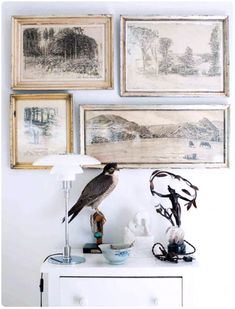 love this vintage art wall with bright white accents