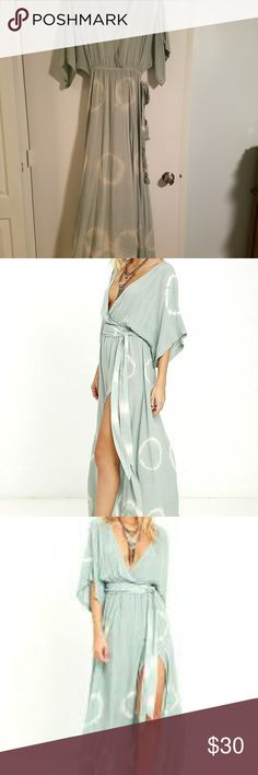 Mint green tie die Maxi Gorgeous and sexy light mint green dress from Lulu's.  It has a deep slit. Super sexy, yet covered. Comes with matching belt. Worn once and dry cleaned. Size small Lulu's Dresses Maxi