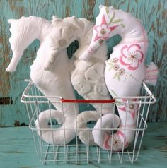 Seahorse Pillows: http://www.completely-coastal.com/2014/01/sea-life-shaped-pillows-starfish-sand-dollar-seahorse.html