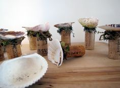 Glue a shell on top of a wine cork, add some moss = birdbath
