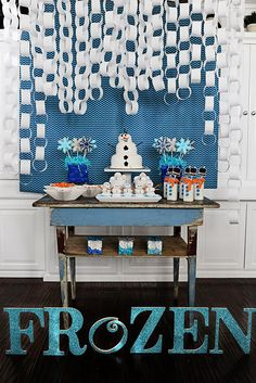 Easy and inexpensive white paper chains hung at various lengths mimicked the look of falling snow over the dessert table.