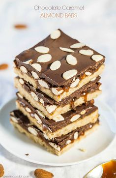 Chocolate Caramel Almond Bars - Buttery shortbread, caramel, chocolate and almonds GALORE!! Easy and perfect for almond lovers!!