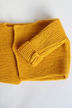 handknitted mustard colour baby sweater