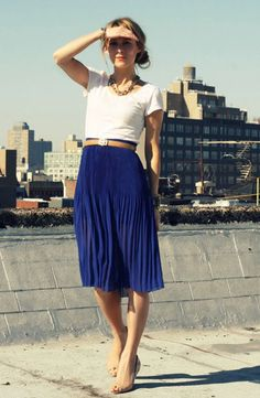 blue skirt, white tee, neutral belt and shoes