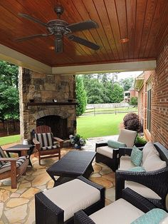 Traditional Porch, exterior stone floors, Wood paneled ceiling, specialty window, and outdoor fireplace! Add an outdoor kitchen... sold!