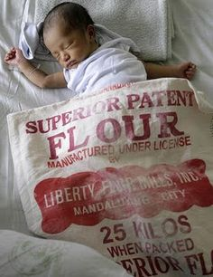 I'm so into vintage flour sacks...want to collect my own and make pillows...never thought of making a baby blanket out of them, but now I HAVE to!!  Soooo cute!!