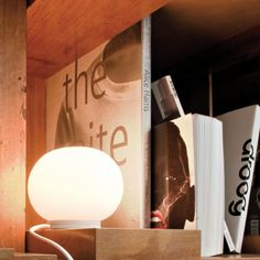 Mini Glo-Ball T Modern Table Lamp designed by Jasper Morrison for FLOS is a great gift for coworkers, your boss, or an avid reader. Cool Lighting, Lighting Design, Task Lighting, Lighting Ideas, Light Table, A Table, Mid Century Modern Lighting, Contemporary Table Lamps, Modern Table