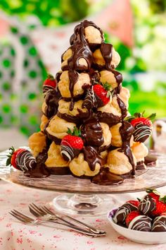 Profiteroles with cream and chocolate sauce, stacked up high like a croquembouche, makes this one showstopping dessert