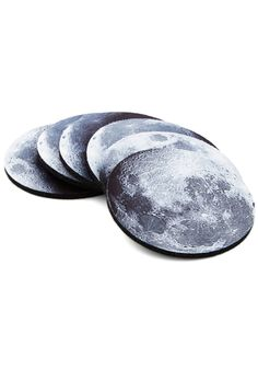 Phase and Nights Coaster Set | Lay your beverage atop one of these moon phase coasters and transform your 'space' for a creative gathering! Each of these six non-slip, cushioned coasters is printed with a photorealistic lunar phase, so your guests can enjoy the wonder of the night sky without leaving your living room.