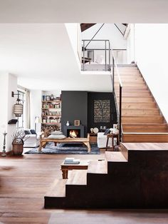 stairs to side, wooden accent with black sides. And metal black rails