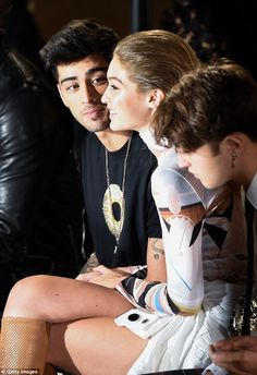 Locked in talk: The former One Direction hunk, 24, looked enticed by the conversation he shared with the 21-year-old supermodel and her younger sibling