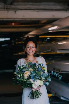 Modern cross-cultural wedding inspiration. Lace wedding dress and oversized bridal bouquet.  Styling by Nulyweds, Photo by Anne Schwarz, Flowers by Ricky Paul Flowers