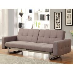 Designed to be multi-functional, this futon sofa offers a versatile structure that will surely be of use and comfort. The warm brown upholstery pairs beautifully with any living decor while the metal base supports in style.