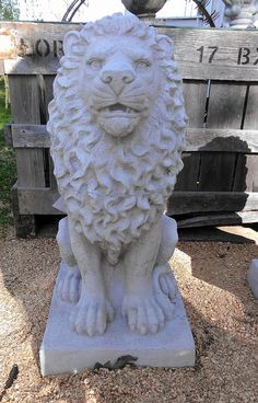 Concrete lion -medium and unpainted.  They look great painted black!
