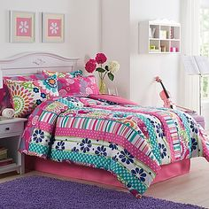 Bring a fun and bright look to your little girl's bed with the Ronda Comforter Set. Pieced with an array of floral prints, stripe prints, and polka dots in vibrant colors, the adorable bedding is the perfect girly touch to her bedroom.