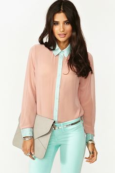 outfit: nude-pink / baby-blue contrast-cuffed contrast-collared contrast blouse, baby-blue skinny-jeans, silver belt, silver bracelets, silver rings, neutral envelope clutch