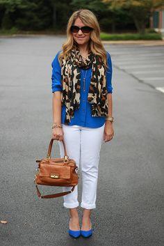 White pants, blue shirt, leopard scarf