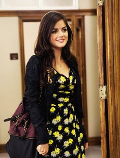 Pretty Little Liars Aria loving the sunflower yellow buds on this black dress. So cute!